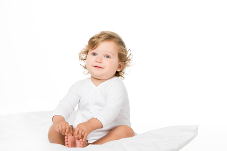cute toddler girl looking away isolated on white
