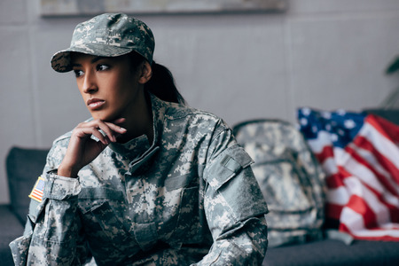 pensive african american female soldier in military uniform