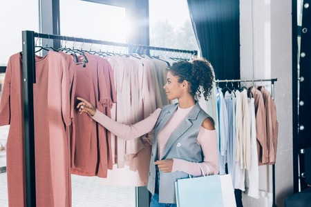 beautiful young woman on shopping in clothing store Stock Photo