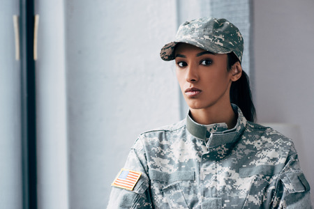 african american female soldier in military uniform with usa flag emblem