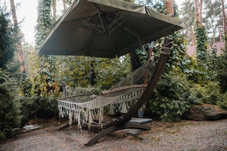 cozy hammock in courtyard near country house