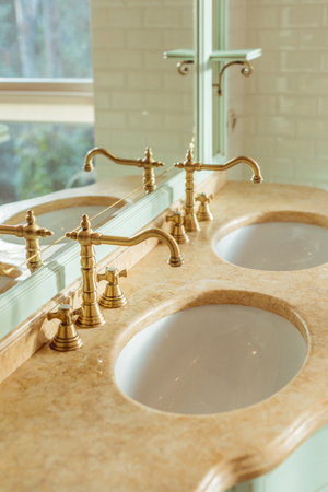 close-up view of two luxury sinks and mirror in bathroom interior
