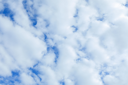 full frame of white clouds on blue sky background