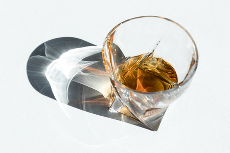 high angle view of luxury cognac in glass on white