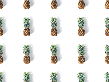 background from ripe juicy pineapples with shadows on white   Stock Photo