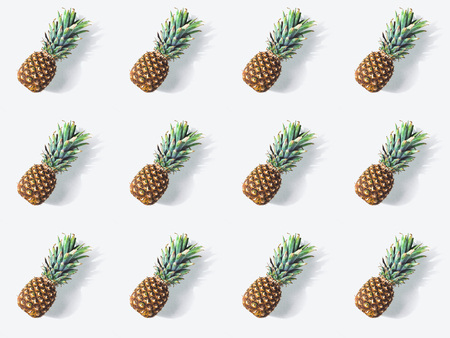 pattern from ripe fresh pineapples with shadows on white