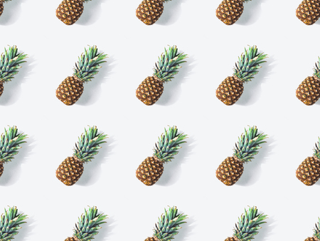 pattern from ripe juicy pineapples with shadows on white