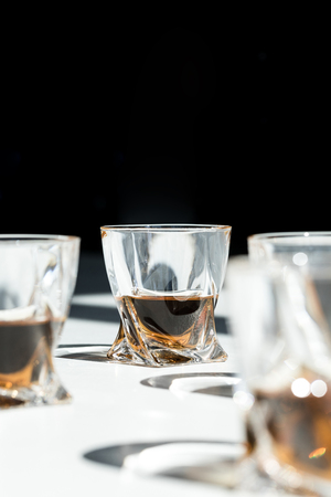 close-up view of luxury whiskey in glasses on black