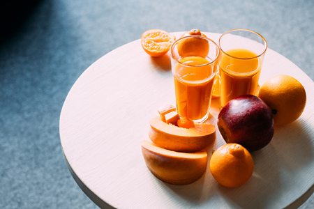 high angle view of organic orange smoothie and fresh fruits with pumpkin on table   Stok Fotoğraf