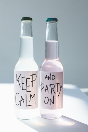 alcoholic beverages in bottles with inscriptions keep calm and party on on labels