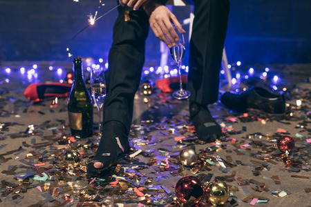 partial view of man with ripped sock at christmas party
