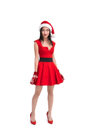 asian woman in santa costume and mittens isolated on white