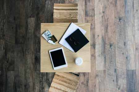 top view of business workplace on table in cafe