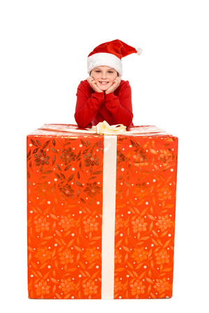 boy in santa hat with big christmas present, isolated on white