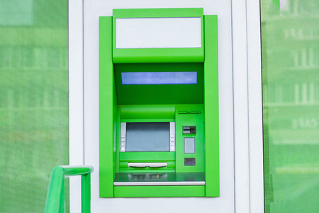 atm cash machine in wall of bank
