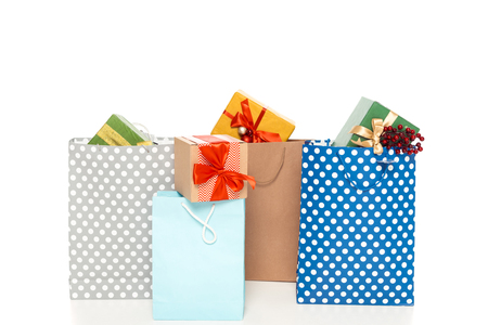 colorful shopping bags with gift boxes, isolated on white