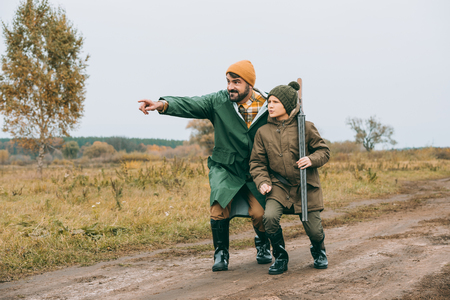 Father showing something to son at hunt Stockfoto - 102617728
