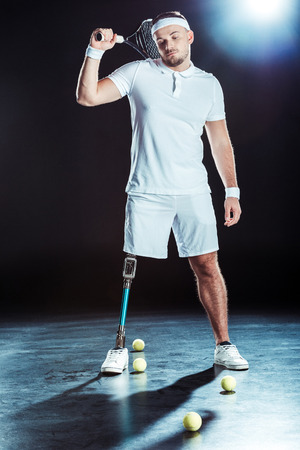 young  tennis player holding tennis racket in hand Stock Photo