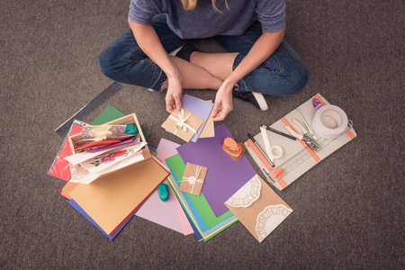 cropped shot of woman doing decorative handmade card at home Stockfoto