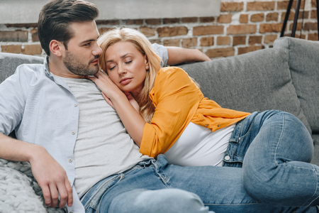 young beautiful couple relaxing on couch together