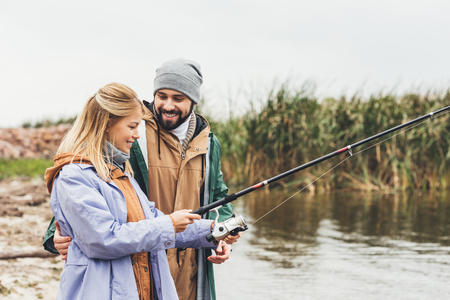 beautiful couple fishing together on cloudy day Stock fotó