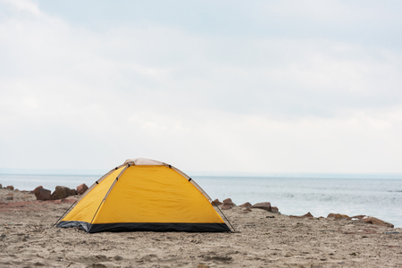 lonely camping tent standing on seahore