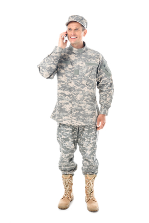 smiling military man in talking by phone isolated on white
