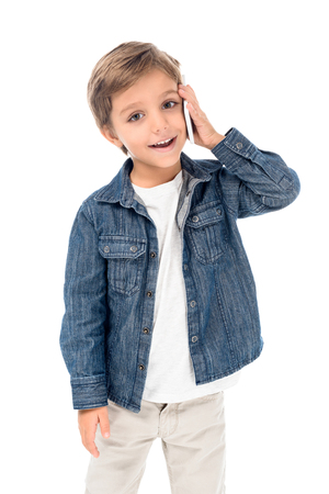 portrait of adorable little boy talking on smartphone isolated on white Stock Photo