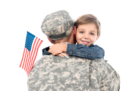 father in military uniform embracing with son isolated on white