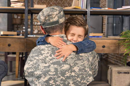 military father and adorable little son embracing Banco de Imagens
