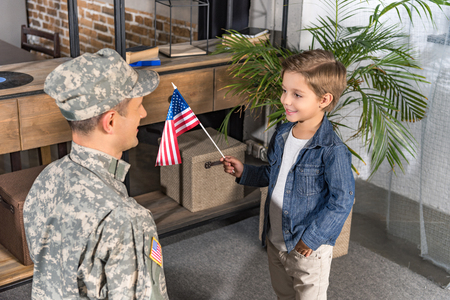 happy military father and son with usa flag at home Stock Photo