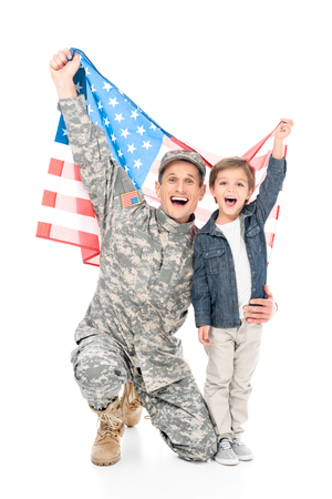 excited little boy and father in military uniform holding american flag together isolated on white