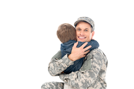 happy handsome father in military uniform embracing with son isolated on white Stock Photo
