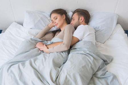Young couple sleeping peacefully and hugging in bed Standard-Bild - 102650531
