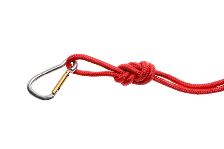 close-up view of red rope with knot and carabiner isolated on white Фото со стока