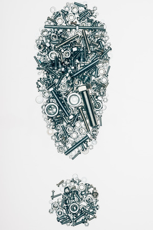 top view of mechanic details arranged in exclamation mark isolated on white Reklamní fotografie