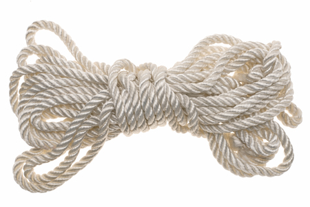 close-up view of white tied rope isolated on white