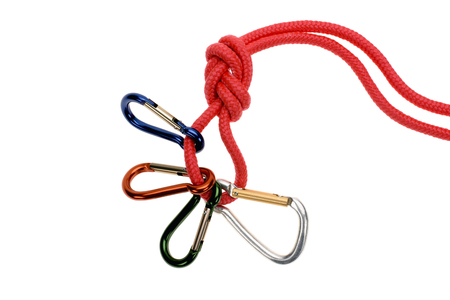 close-up view of red rope with carabiners isolated on white
