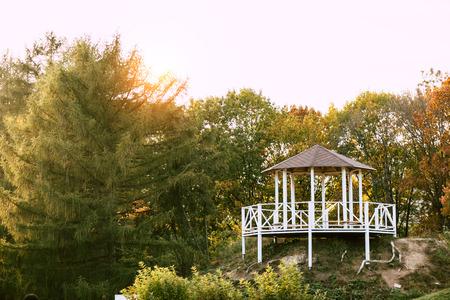 alcove near lake in beautiful autumn park