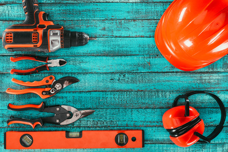 flat lay with various carpentry equipment on blue wooden surface Stock Photo - 102653776