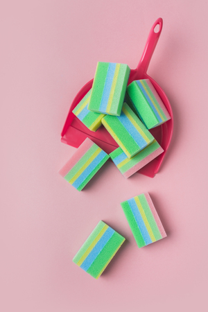 top view of colorful washing sponges in scoop, isolated on pink Stok Fotoğraf