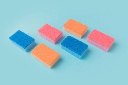 colorful washing kitchen sponges, on blue