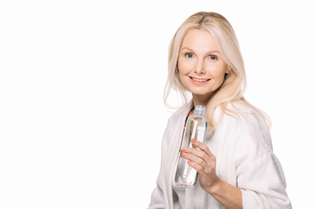 mature woman with bottle of water isolated on white