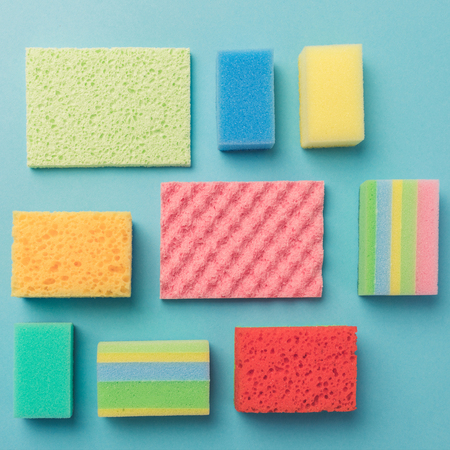 top view of background with colorful washing sponges, on blue Reklamní fotografie