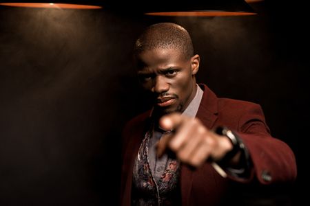 handsome serious african american man pointing at you Stock Photo