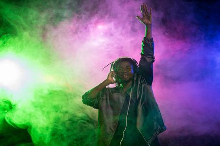 professional african american club DJ in headphones on music concert