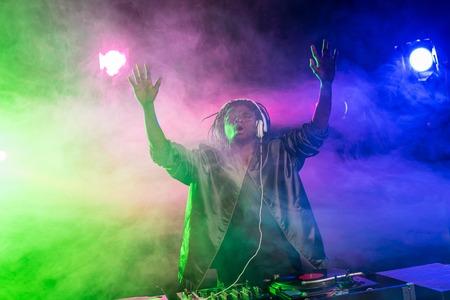 professional african american club DJ in headphones in nightclub  Stock Photo