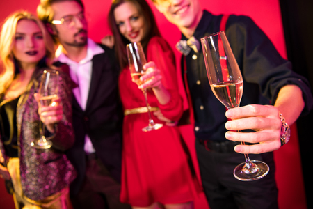 selective focus of two glamorous stylish couples drinking champagne Banque d'images - 102660915