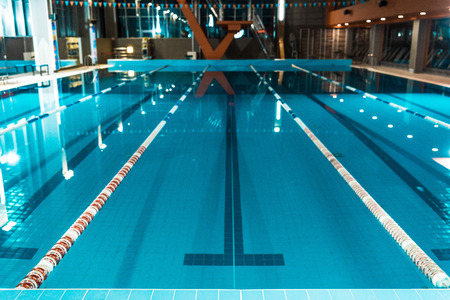 horizontal view of lanes of a competition swimming pool