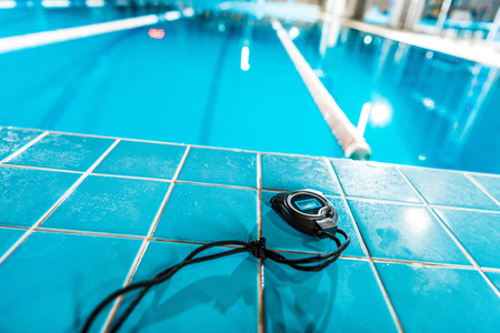 timer lying at competition swimming pool Zdjęcie Seryjne
